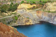 Blue lake in old abandoned quarry of Racos, Brasov, Romania Stock Photos