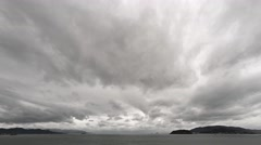 Abstract Timelapse Clip of Dense Clouds Scuttling across a Seascape Stock Footage