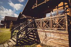 Traditional wooden cottage with big terrace Stock Photos