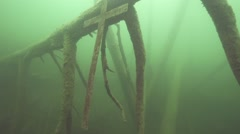 metal cross submerged underwater in lake - stock footage