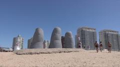 Punta Del Este, Hand in Sand sculpture on beach, Uruguay - stock footage