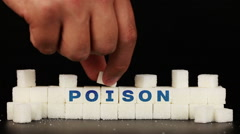 Man's hand puts sugar cubes on which is inscriptionthe word poison Stock Footage