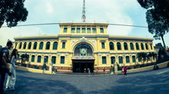 People pass by and take pictures near the post office in Ho Chi Minh City Stock Footage
