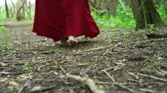 Young renaissance girl walking through woods barefoot 4k - stock footage
