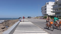 Punta Del Este, tourists and cyclists on the promenade, Uruguay Stock Footage
