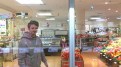 Male shopping at grocery store in Frankfurt Germany Stock Footage
