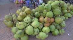 Selling fresh coconuts at market. - stock footage