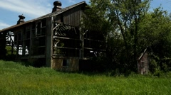 An old rundown barn on a shut down farm Stock Footage