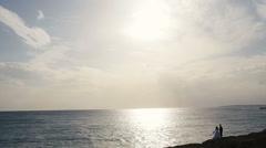Romantic young wedding couple on amazing sunset. Rocky landscape. Cyprus Stock Footage