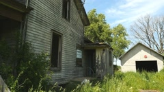 An abandoned old farm house on a closed down farm Stock Footage