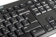 Electronic collection - black computer keyboard with key enter - stock photo