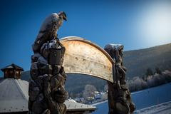 Wooden copyspace signboard at ski resort - stock photo