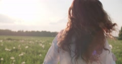 Happy girl with long hair having fun outdoor. Countryside. Nature. Freedom. Slow - stock footage