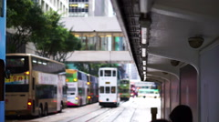 Hong Kong tram transportation. People and station Stock Footage