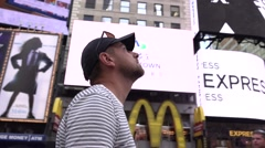 Alien in New York city. Time square. Smooth motion around the man - stock footage