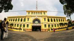 People take pictures near the ancient post office in Ho Chi Minh City Stock Footage