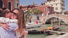 Happy Couple Embracing Canal Boat Bridge Travel Tourist Loving Fun Destination - stock footage
