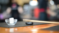Refreshing napkin and chopsticks in Japanese restaurant Stock Footage