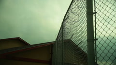 Secure facility barbed wire Stock Footage