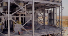 Close range aerial footage of construction work on a large industrial plant - stock footage
