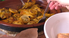 People having chicken and lemon tagine Stock Footage