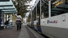 Dutch Tram Exiting  Street Station -  Amsterdam Netherlands Stock Footage