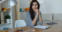 Looking for inspiration. Young beautiful pensive woman making some notes - stock footage