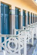 Beach closets with famous names in Deauville, France - stock photo