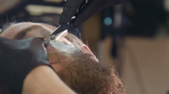 Close-up of man being groomed - stock footage