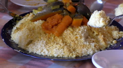 Couscous and vegetables at Moroccan home Stock Footage