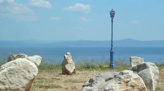 Blue lantern and stones on the sea Stock Footage