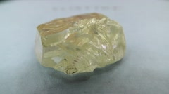 Rio Tinto's 187.7 carat Diavik Foxfire rough diamond Stock Footage