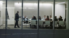4K Diverse business team in late night boardroom meeting in modern office - stock footage