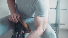 Man doing dumbbell concentration curl - stock footage