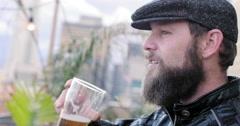 Bearded man drinks beer in Downtown LA at dusk 4K Stock Footage