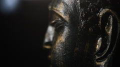 Buddha face, figure buddhist, rotating at black background with smoke Stock Footage