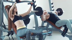 Close-up of couplee doing bench press Stock Footage