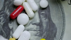 Drugs and money. Medical pills falling down on dollars. Stock Footage
