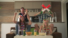 Cheering fan couples at home Stock Footage