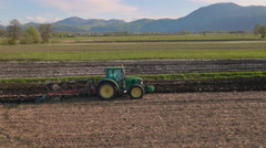 Aerial: Tractor Cultivating a Field Stock Footage