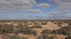 Moving Driving Shot of Australia Outback Desert Under Blue Sky Stock Footage