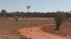 Arid Dry Barren Parched Ranch in Australia Outback with Windmill Stock Footage