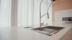 Tracking shot of a large modern kitchen - stock footage