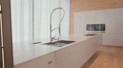 Modern kitchen with faucet and stoves - stock footage