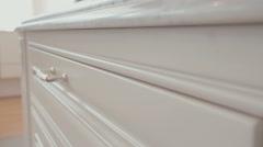 Macro tracking shot of a white luxury kitchen drawer - stock footage