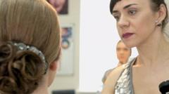 Makeup artist making make-up for stylish model - stock footage
