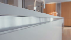 motion shot of the side of a kitchen granite surface - stock footage