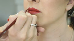 Makeup artist making make-up for stylish model - stock footage
