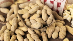 Nuts peanuts lying on a wooden table Stock Footage