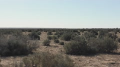 Driving Shot of Barren Desert Shrubland in Australia Outback Stock Footage